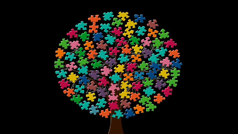 Illustrerat träd med pusselbitar i olika färger som symboliserar integration. Illustration: geralt från Pixabay